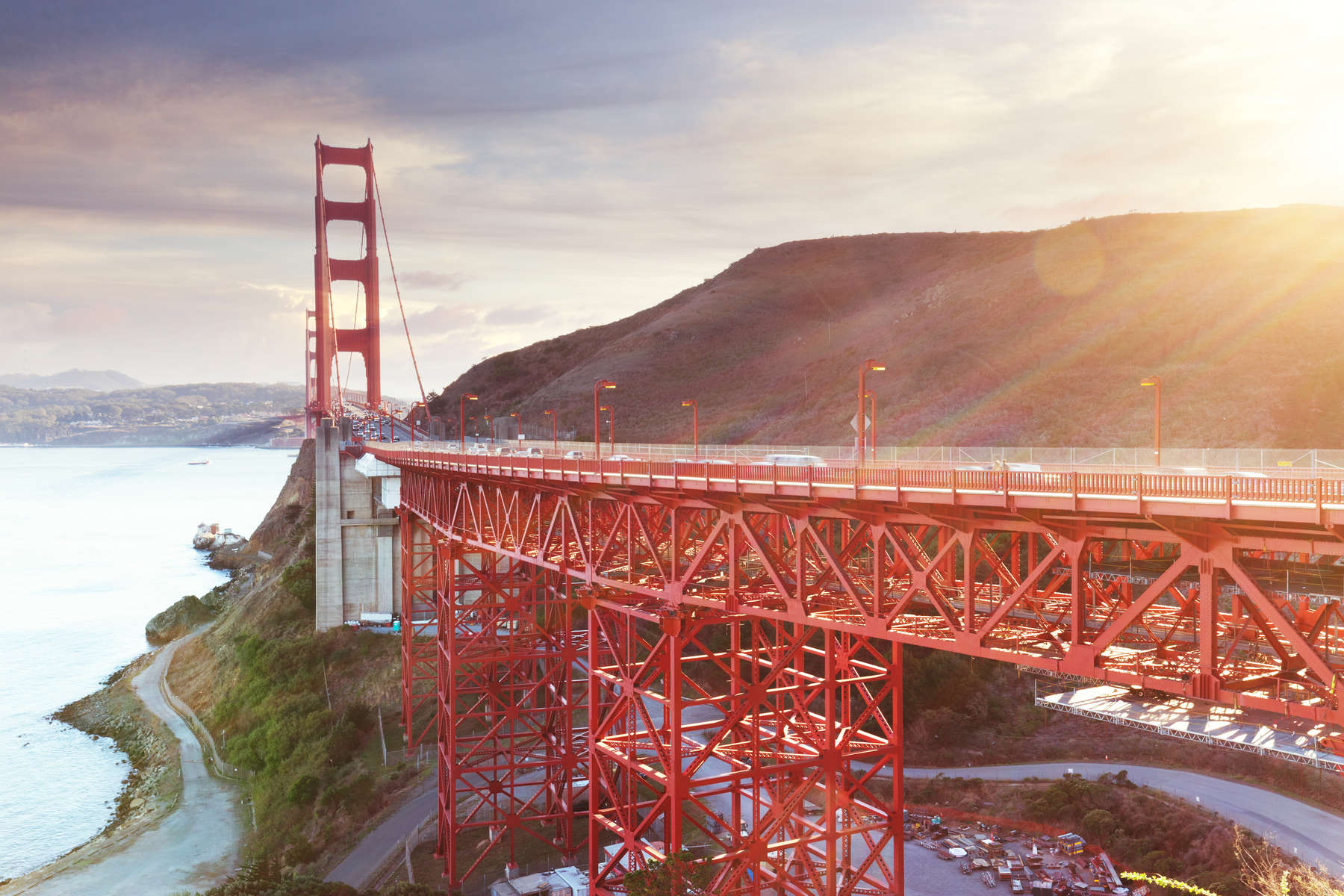 closeup of structure of Gold Gate Bridge at sunrise